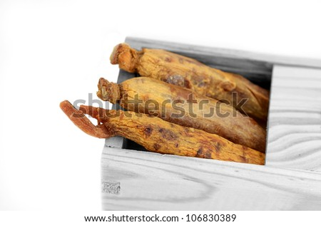 Korean red ginsengs in their box - stock photo