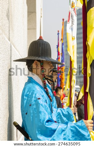 Korean soldier costume vintage around Gyeongbokgung palace  Seoul, South Korea - April 11, 2015: Koreans in Traditional Costumes on duty of the Royal Guard Ceremony at Gyeongbokgung Palace - stock photo