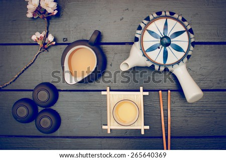 Korean traditional  green tea set for one and a cherry blossom flower - stock photo