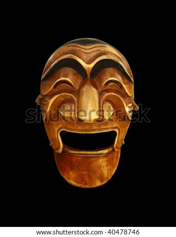 Korean traditional male mask carved of wood on black background