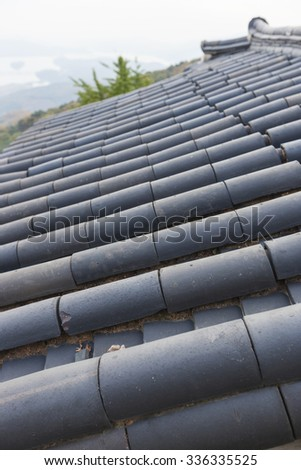 Korean traditional tiled roof in the Sujongsa temple at the fall(autumn). - stock photo