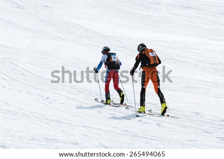 KORYAK, AVACHA VOLCANOES, KAMCHATKA, RUSSIA - APRIL 27, 2014: Team ski mountaineers climb the mountain on skis. Team Race ski mountaineering Asian, ISMF, Russian and Kamchatka Championship. - stock photo