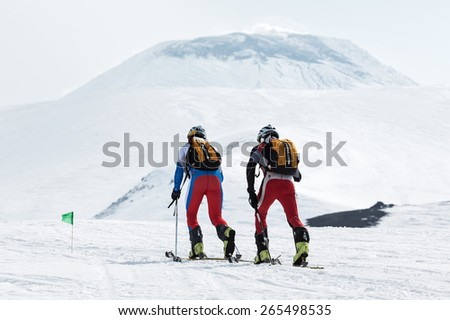 KORYAK, AVACHA VOLCANOES, KAMCHATKA, RUSSIA - APRIL 27, 2014: Team ski mountaineers climb the Avachinsky Volcano on skis. Team Race ski mountaineering Asian, ISMF, Russian and Kamchatka Championship. - stock photo