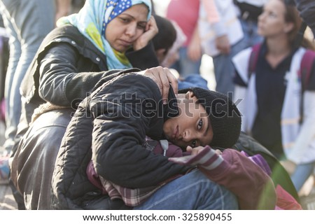 Kos, Greece - October 10, 2015: Syrian refugee and her child at a volunteer's camp - stock photo