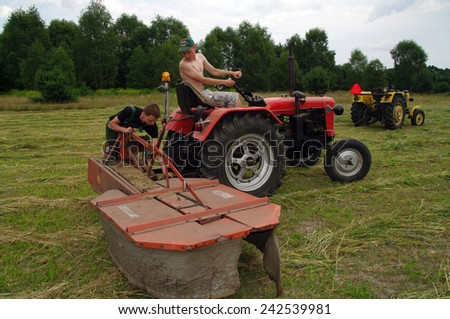 KOSMIDRY, POLAND - July 01, 2014 Old tractor repair in the field and and friendly help neighbors