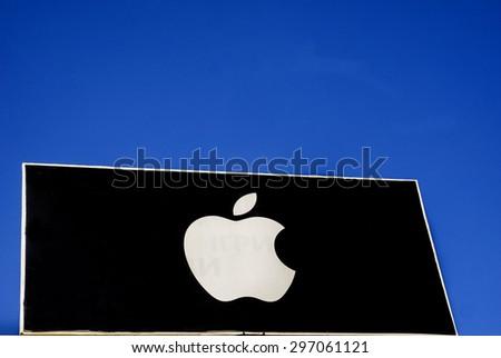 KOSOV, IVANO-FRANKIVSK REGION, UKRAINE - July 16, 2015: Apple resseler sign against blue sky - stock photo