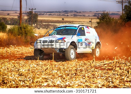 KOSTER, SOUTH AFRICA - July 11:  Africa-Offroad Racing Rally,  on July 11, 2015 at Koster, North West Province, South Africa.  HD - BMW truck kicking up dust on turn at rally.  - stock photo