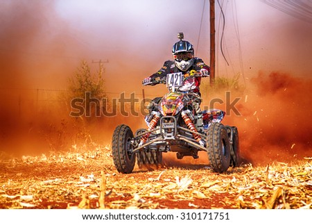 KOSTER, SOUTH AFRICA - July 11:  Africa-Offroad Racing Rally,  on July 11, 2015 at Koster, North West Province, South Africa.  hd Quad Bike kicking up trail of dust on sand track during rally race.