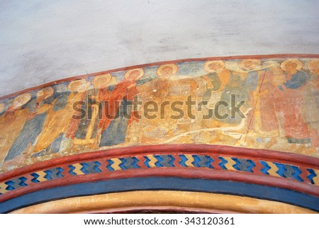 KOSTROMA, RUSSIA - SEPTEMBER 11, 2013: View of old religious painting on the church facade in Ipatyevsky monastery in Kostroma, Russia. Popular landmark. - stock photo