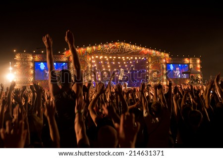KOSTRZYN NAD ODRA, POLAND - AUGUST 2, 2014: Fans during concert Coma at the Festival Przystanek Woodstock. Przystanek Woodstock is the biggest open music festival in Europe. - stock photo