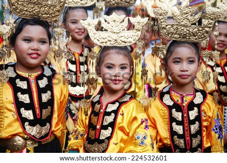 "Kota Belud, Sabah, Malaysia, Okt 18, 2014 : Young girls from the Bajau ethnic wearing their traditional costume and headdress called ""Sarimpak"" for  the 4th Usunan Festival competition in Kota Belud."