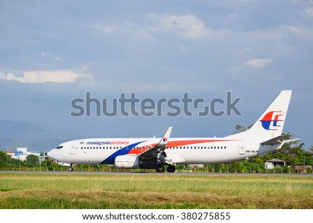 Kota Kinabalu Sabah Malaysia - Feb 22, 2016 : Malaysia Airlines Boeing 737-800 taxing at Kota Kinabalu Airport. The airlines is own by Malaysian government and currently under business restructuring. - stock photo