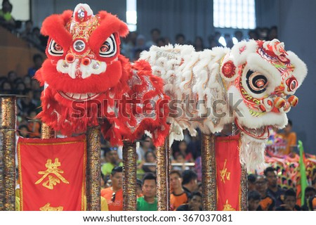 Kota Kinabalu Sabah Malaysia - Jan 23, 2016:Lion dance in action during Chinese New Year (CNY) celebration in Kota Kinabalu.CNY is among major celebration in multiethnic Malaysian. - stock photo