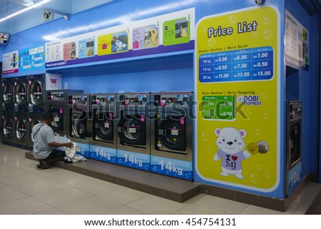 Kota Kinabalu Sabah Malaysia - Jul 19, 2016 : Self-service laundry shop at Kota Kinabalu city pictured on Jul 19, 2016. The 24 hours laundry is now popular in the city especially among traveller.