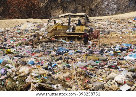 Kota Kinabalu Sabah Malaysia - Mar 17, 2016 : Scavengers collecting recyclable material at dumping site in Sabah.Rubbish segregation is hardly impose in Malaysia beside many campaign by government.