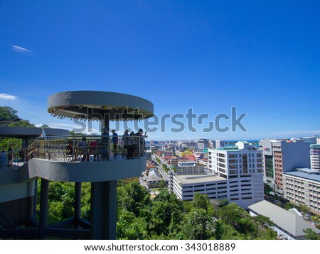 Kota Kinabalu,Sabah,Malaysia-November 7,2015: Undentitified group of tourist taken photo Kota Kinabalu city view from Signal Hill Observatory Tower.