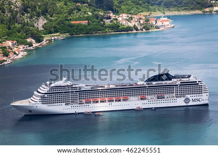 KOTOR, MONTENEGRO-CIRCA JUN, 2016: Large white cruiseferry of MSC Cruises Swiss-registered company is on the Kotor Bay. The MSC Orchestra cruise ship.