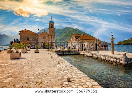 KOTOR,MONTENEGRO-JULY 19:Tourists in famous Church Our Lady of the Rocks. Our Lady of the Rocks is one of the two islets off the coast of Perast in Bay of Kotor, on July 19, 2014 in Kotor, Montenegro. - stock photo