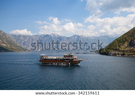 KOTOR, MONTENEGRO - SEPTEMBER 13, 2015 : Cruise ship with tourists in Boka Kotorska Bay. Kotor has one of the best preserved medieval old towns in the Adriatic