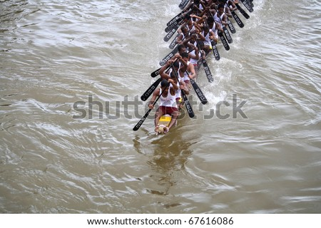 KOTTAYAM, INDIA - AUGUST 29 : A Snake boat team in the Kottayam Boat race on August 29, 2010 in Kottayam, India. - stock photo