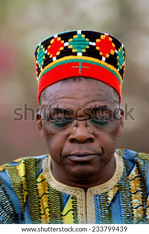 KOUPELA, BURKINA FASO - FEBRUARY 19: Portrait of Kokemnoure village chief in Burkina Faso in full thought, February 19, 2007. - stock photo