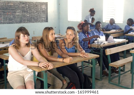 KOUPELA - BURKINA FASO - FEBRUARY 26, 2007: Visit of French schoolboy in Africa with the college Saint-Philippe. The pupils are in of a the same class level than in their French school.