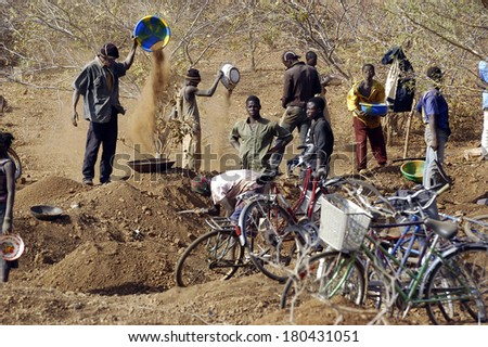 KOUPELA, BURKINA FASO - JANUARY 12: wild golden Koupela mine, the gold diggers come from everywhere to dig, hoping to find fortune and work in poor conditions for little gold, January 12, 2008. - stock photo