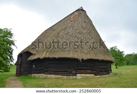 KOURIM - MAY 24: Traditional polygonal barn from the 17th century, Czech republic. Open-air museum of folk architecture, Kourim. May 24, 2014 - stock photo