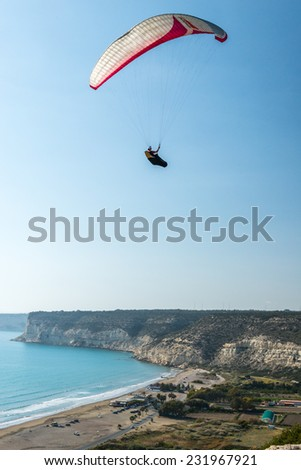KOURION, CYPRUS - MARCH 19, 2014 - Lone paraglider flying high over Kourion on the south coast of the Mediterranean island of Cyprus.
