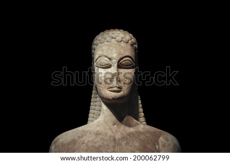 Kouros of the sacred gate ancient statue of young man on black background. Kerameikos museum, Athens Greece. - stock photo