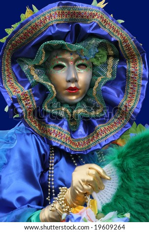 KOUROU, FRENCH GUIANA - FEBRUARY 11: this 'touloulou' (in creole language) participates in the main carnival parade February 11, 2007 in Kourou, French Guiana. The yearly theme contest is the NATURE. - stock photo