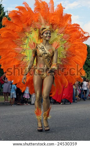 KOUROU, FRENCH GUIANA - JANUARY 28: the queen of a Brazilian group participates in the main carnival parade January 28, 2008 in Kourou, French Guiana. The yearly theme contest is ORANGE. - stock photo