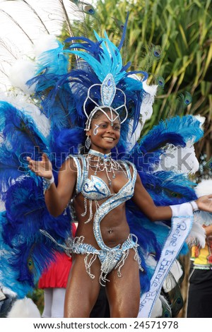 KOUROU, FRENCH GUIANA - JANUARY 28: this woman of a Brazilian group participates in the main carnival parade January 28, 2008 in Kourou, French Guiana. - stock photo