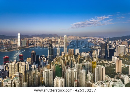 KOWLOON, HONGKONG - JAN 9, 2010: Hong Kong view from Victoria Peak to the bay and the skyscraper in sunset, Kowloon, Hongkong. - stock photo