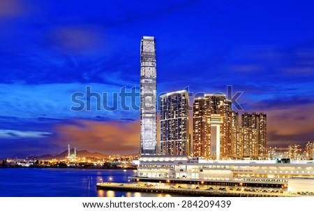 Kowloon office buildings at night, hong kong - stock photo