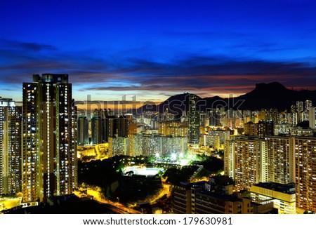 Kowloon side in Hong Kong at night - stock photo