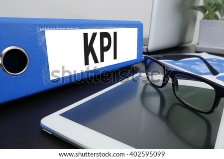 KPI CONCEPT Office folder on Desktop on table with Office Supplies. ipad - stock photo