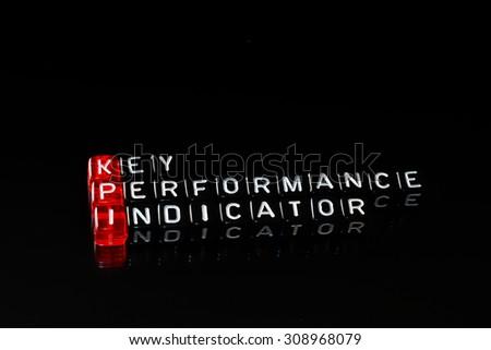 KPI Key Performance Indicator written on dices on black  - stock photo