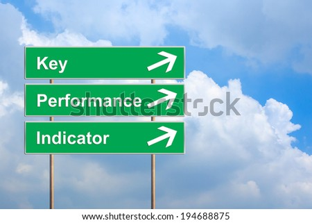 KPI or Key Performance indicator on green road sign with blue sky - stock photo