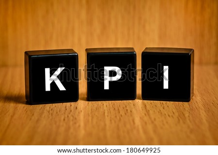 KPI or Key Performance indicator text on black block , business concept - stock photo