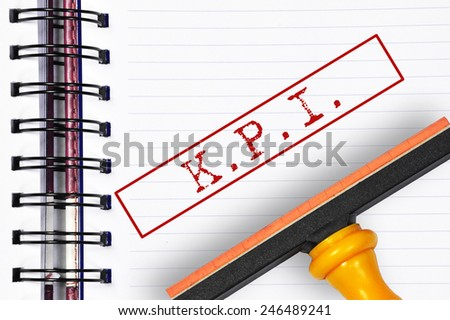 KPI rubber stamp on the note book - stock photo