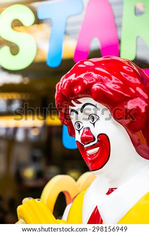 KRABI, THAILAND - July 18, 2015: View of Ronald McDonald in front of a McDonald's  on July 18, 2015 in Krabi, Thailand. McDonald's operates in 119 countries with 160 stores in Thailand. - stock photo