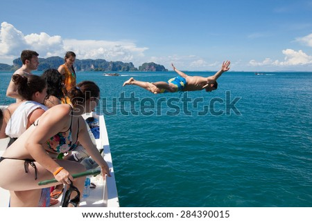 KRABI, THAILAND - MAY 19, 2015: Unidentified people is jumping into the sea.