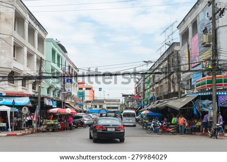 KRABI, THAILAND - 14 OCT 2014: Light traffic on a typical downtown street in central Krabi Town, on a cloudy day. - stock photo