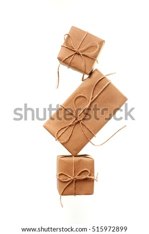 kraft paper tied with string on a white background