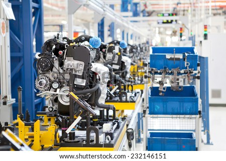 KRAGUJEVAC, SERBIA - CIRCA APRIL 2012: Car engine assembled on the factory production line, circa April 2012 in Kragujevac. - stock photo