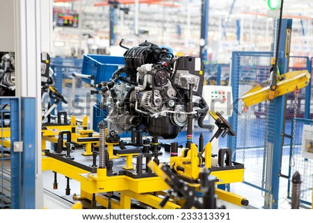 KRAGUJEVAC, SERBIA - CIRCA APRIL 2012: Car engine assembled on the factory production line, circa April 2012 in Kragujevac. - stock photo