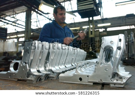 KRAGUJEVAC, SERBIA - CIRCA JANUARY 2007: Workers at arms factory, circa January 2007 in Kragujevac - stock photo