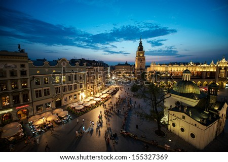 Krakow Market Square at sunset with night lights, Poland - stock photo