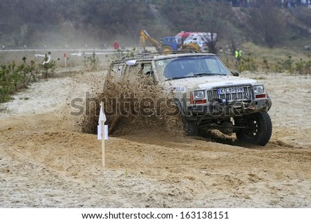 KRAKOW - NOVEMBER 13: Cars taking part in annual off road racing at Kryspinow lake. Krakow, Poland on November 13, 2005. - stock photo
